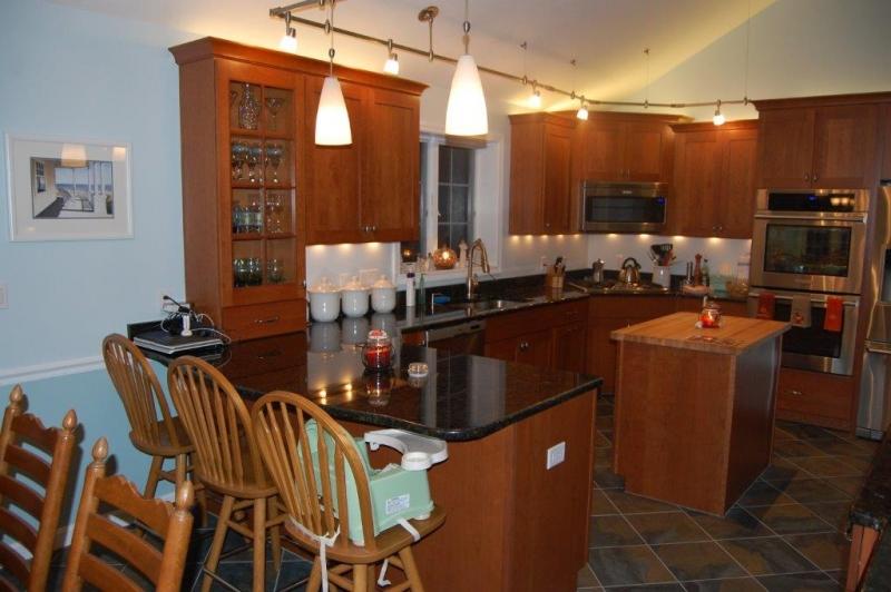 Raised Ranch Retreat - Wood Palace Kitchens, Inc.